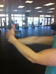 Wrist flexor stretch for medial elbow pain