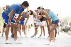 Exhausted marathon runners slow down their breathing to release stomach pain.