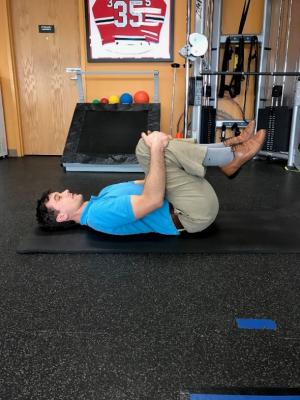 golf off season training knees to chest