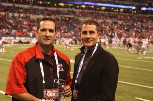 Athletico President Mark Kaufman presents Dave Inserra with the Athletico Coach of the Year Award at the Big Ten Football Championship on December 7 in Indianapolis.