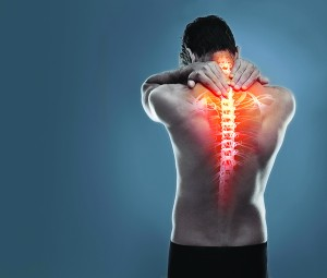 A man holding his back in pain