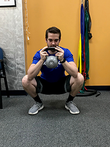 Goblet Squat Dorsiflexion Stretch